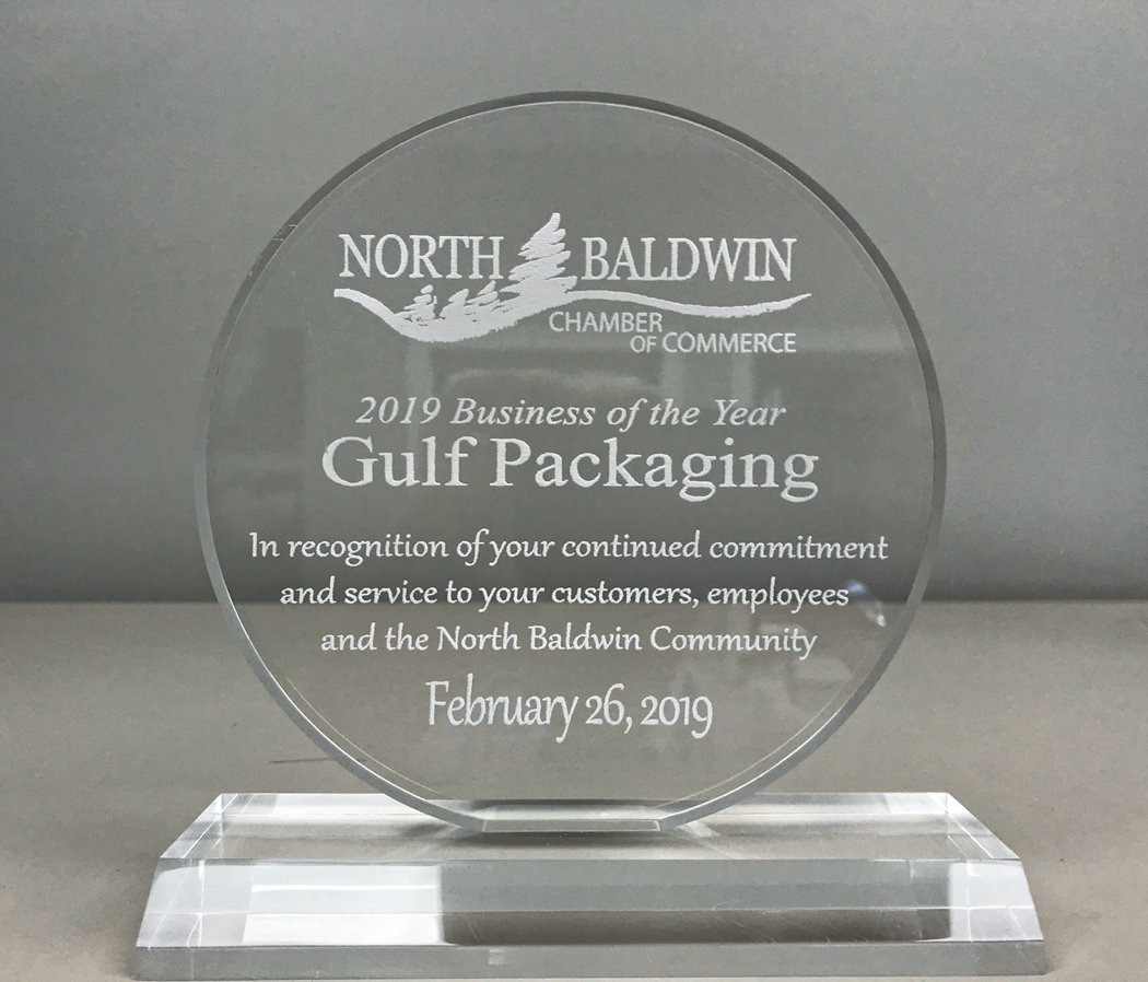 Clear, round, glass small business award for gulf packaging